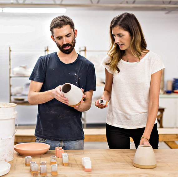 Bill Jones and Erin Reitz review glazes. Photo credit: Artisanal Aperture