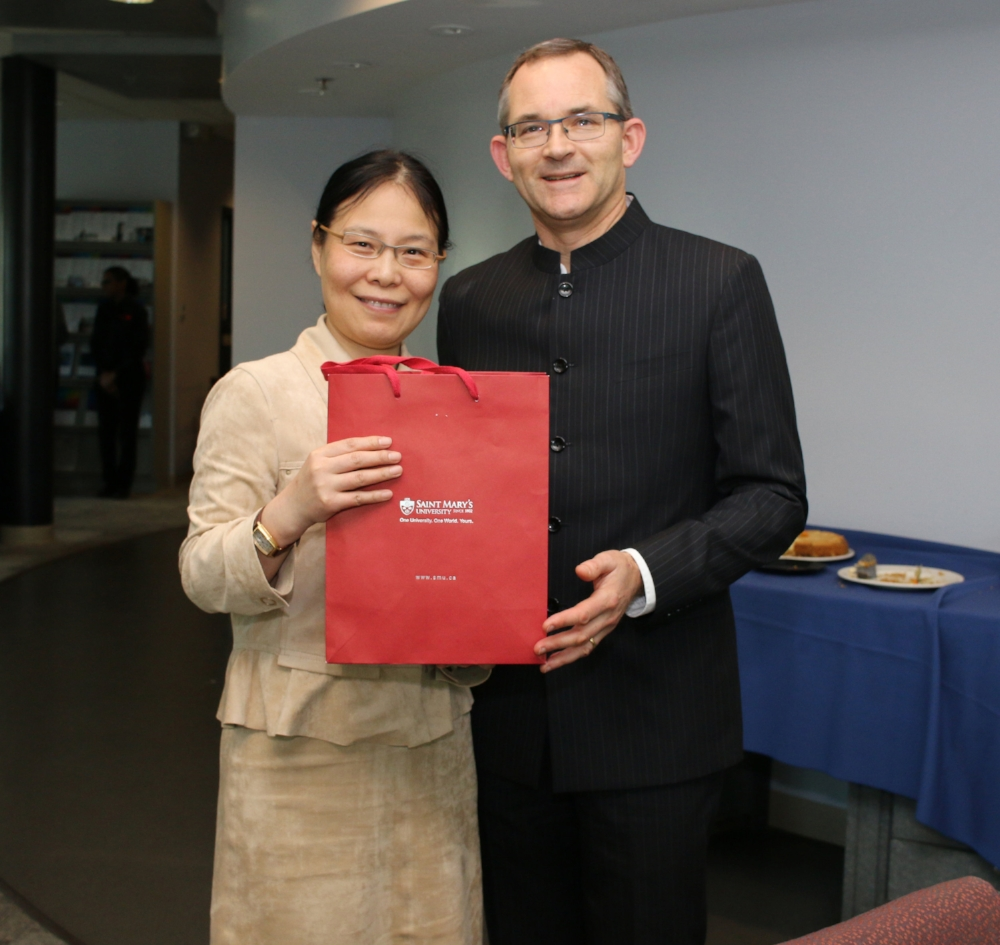Maria Pan receives a gift of appreciation from President Rob Summerby-Murray