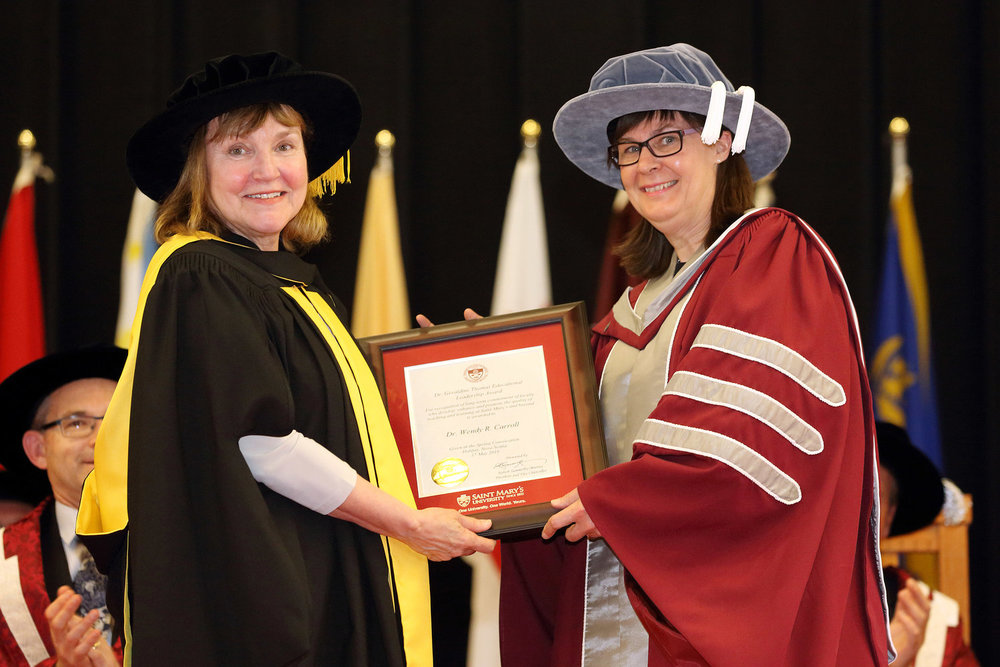 Dr. Wendy Carroll (right) receives the Dr. Geraldine Thomas Educational Leadership Award from Dr. Madine VanderPlaat, Associate Dean of Arts