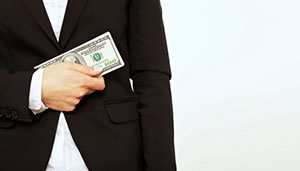 Shutterstock photo of   a man holding money  .