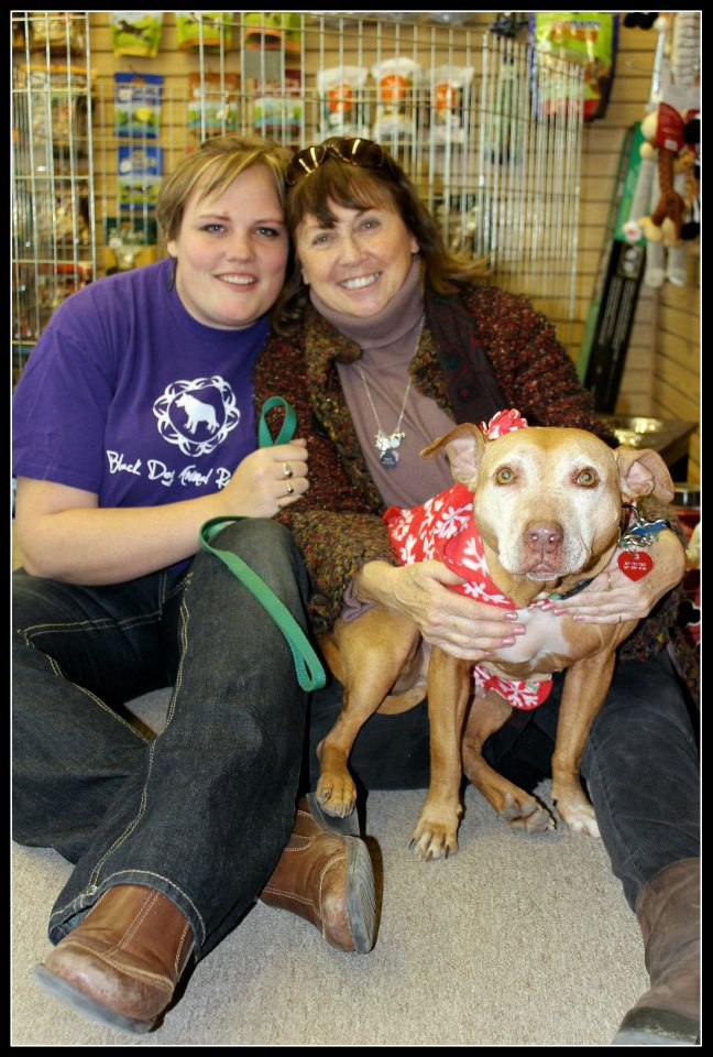 Britney and Susan pose in 2012 with Little Red, who Susan adopted after her rescue from Michael Vick's dog fighting ring.