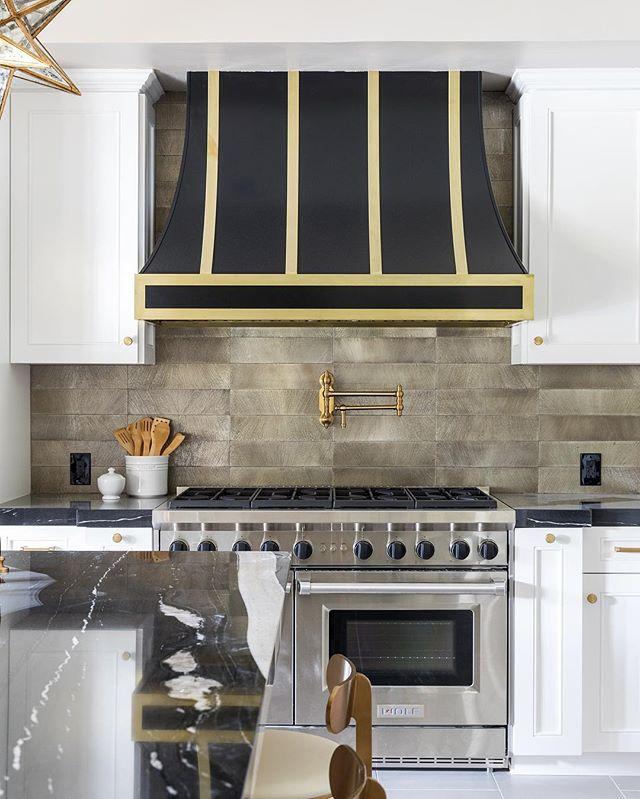 This @ryansaghian kitchen design makes a stylish impact. Love the custom hood and tile work. #kitchendesign #wolfstove #interiordesign #beverlyhills