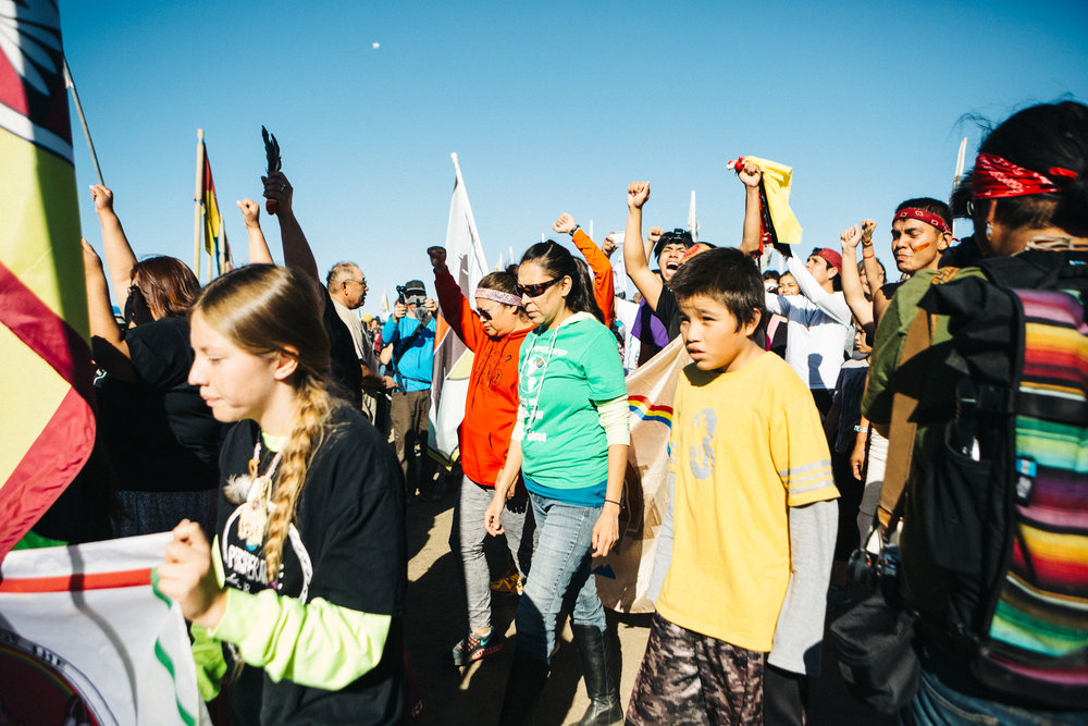 Navajo and Hopi youth arrive after running from Flagstaff in a spiritual show of support. Running is a sacred tradition in Navajo culture.