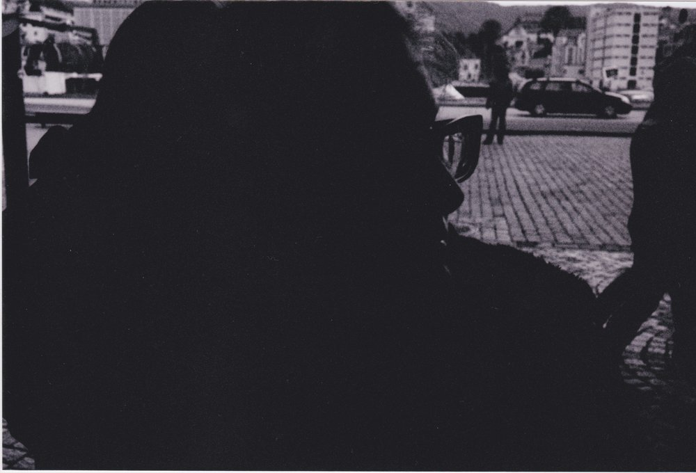 Soph Bonde/Argot Publications   [Image Description: A black and white photo of a silhouette of a woman looking to right]