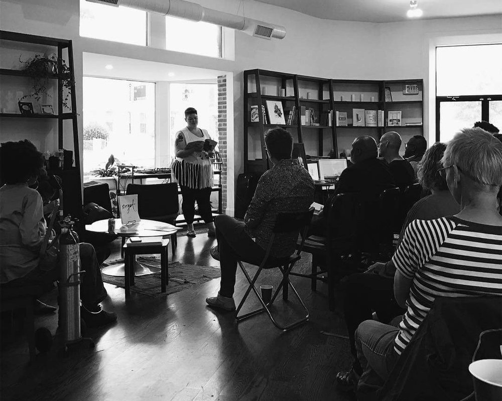 Austen Osworth   [Image Description: Nino Porter-Lupu, Argot's International Editor, reads from Argot's Second Edition in front of a seated audience June 3rd]