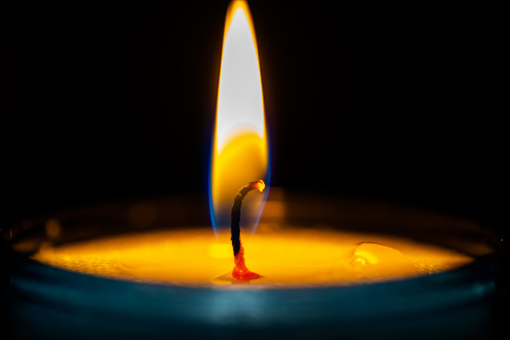 [Image description: close-up photo of a burning candle]   Creative Commons