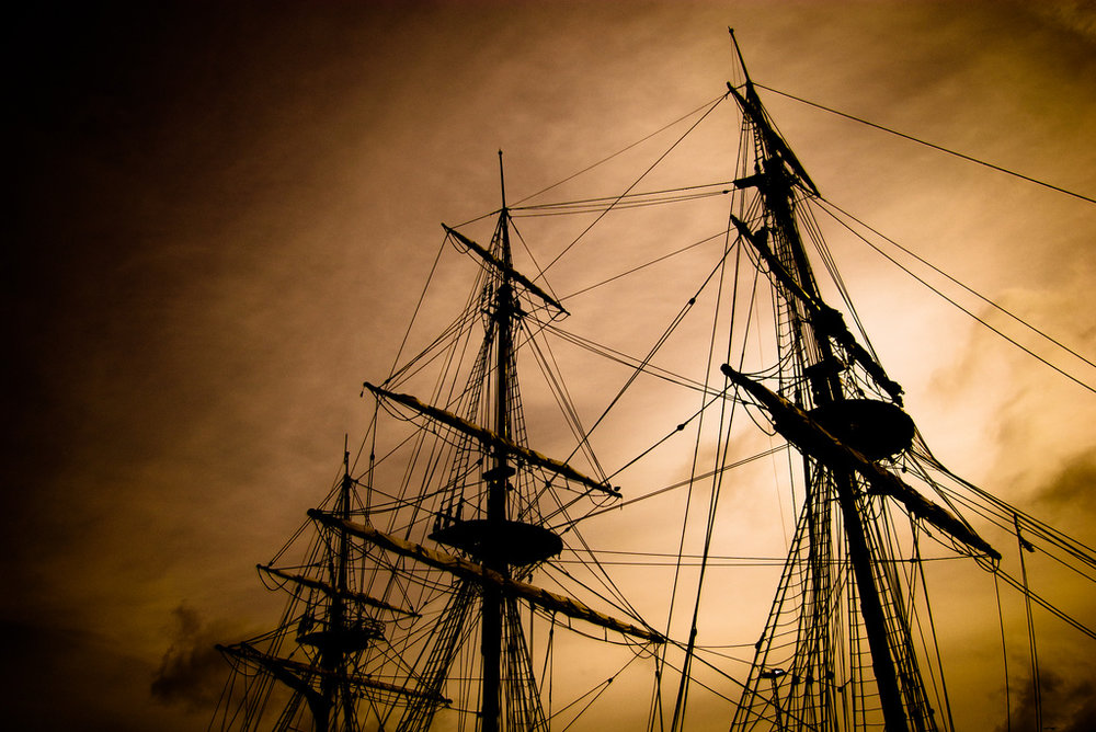 [Image description: photograph of the rigging of a large sailing ship against the backdrop of a cloudy sky.]  Marc Blackburn-Wilson / Creative Commons