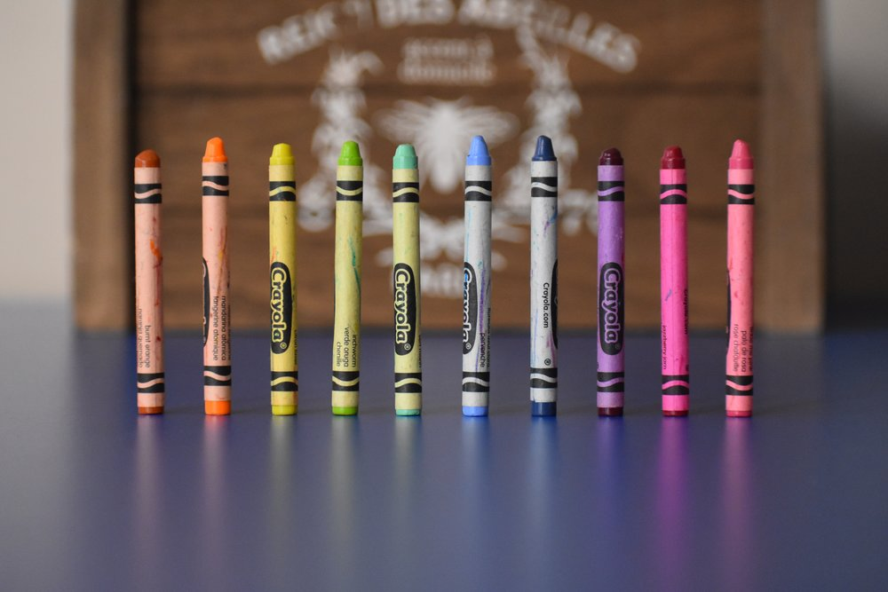 Photo by  Joshua Eckstein  on  Unsplash    [Image Description: a row of Crayola crayons stand upright in chromatic order in the foreground]
