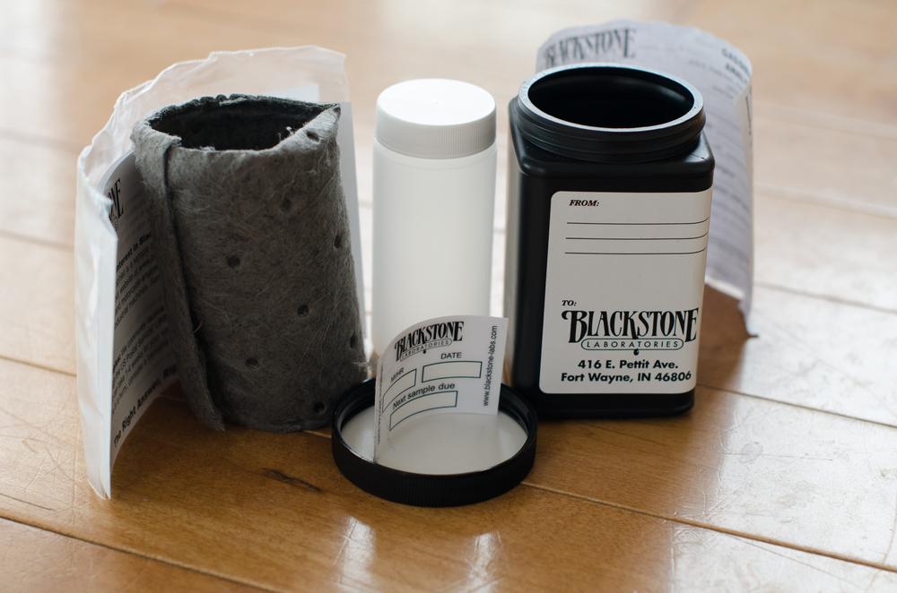 Instructions, ziploc bag, absorent material, white bottle for oil, oil reminder, and black mailer bottle