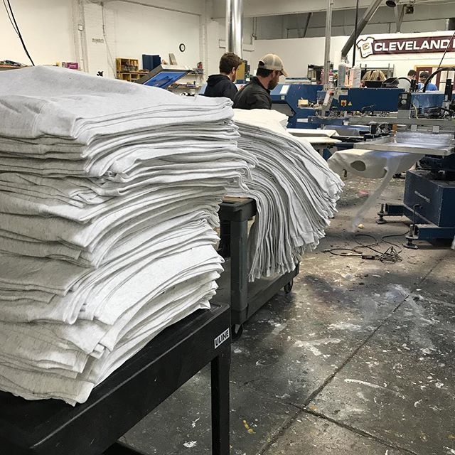 Some STACKS of fleece getting printed today. #CLE winter is approaching quickly!!! #screenprinting #fleece #sweatshirts #cleveland #hanes