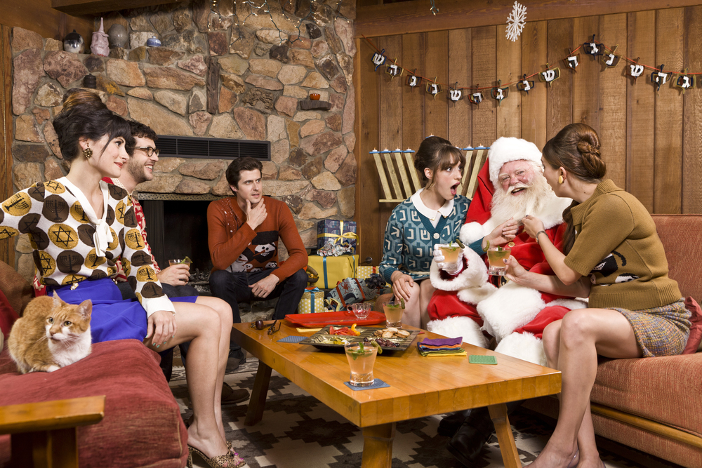 "SPOILER ALERT! Despite having a bazillion presents to deliver, Santa says ""eff it"" and decides to hang out with the Jews for Hanukkah. What can we say? Santa's got good taste. Above, the girls admire Santa's impressive beard, while the guys look on admiringly. The cat clearly doesn't care about beards. Check out the full ""Santa's First Hanukkah"" story  here ."