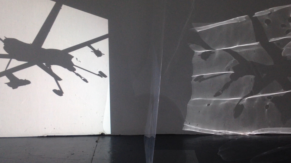 The last 2 screens are constructed from translucent acetate film. The acetate film refracts and bends the video projections that pass through it to reach the vellum screens and architecture of the space.