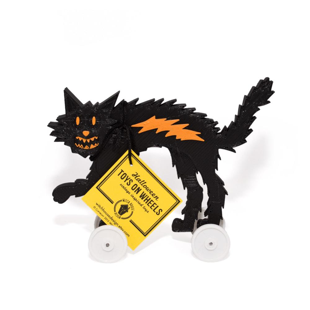 black_o_cat_w_toys.jpg