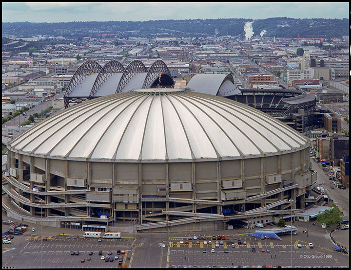 The Kingdome with newly completed Safeco Field behind,  as seen in 1999 looking south from the Smith Tower.