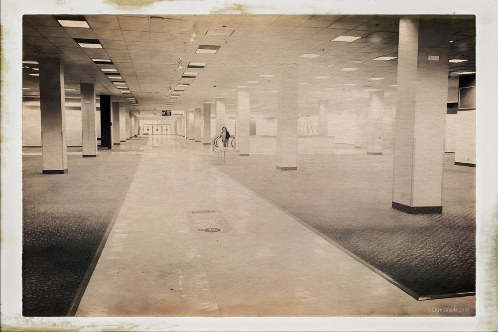 A lone worker stands amid the empty showroom. The Shoreline Sears opened in 1967.