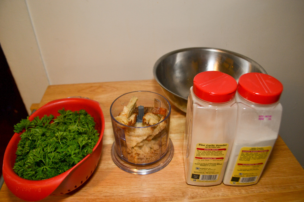 (From left to right) Italian parsley, dried out break in a food processor, metal bowl, fine garlic powder & onion powder