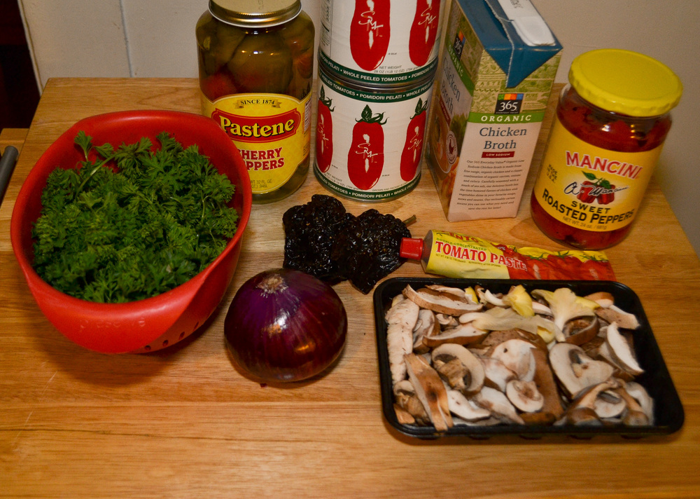 (From left to right) Italian parsley, 32oz. jar of whole cherry peppers, (2) 28oz. cans of whole San Marzano tomatoes, chicken broth, roasted red peppers, red onion, Ancho dried whole chile peppers, tomato paste & one pint of pre-sliced mushrooms