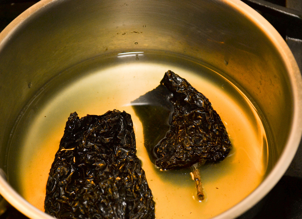 Ancho dried chile peppers in chicken stock