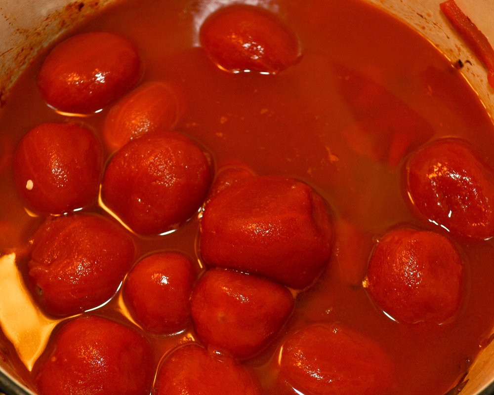 Tomatoes and their juices added to the cooked down vegetable mixture