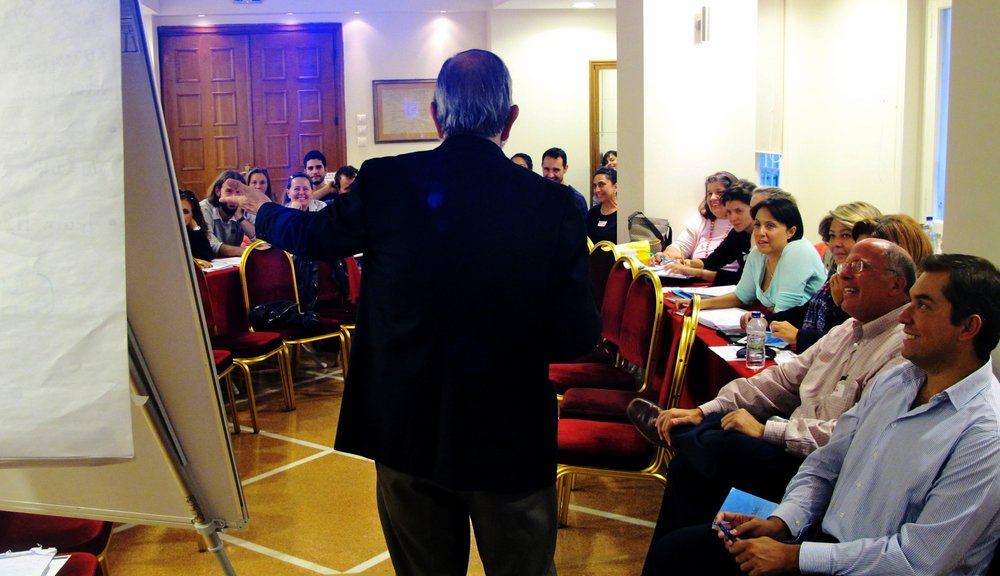 MBB Consultant Alan Gross facilitating a community dialogue in Greece.