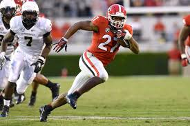 Georgia's dynamic duo of Nick Chubb (above, photo courtesy of Atlanta All Day) and Sony Michel (below, photo courtesy of Online Athens) look to lead the Dawgs back to excellence in 2017