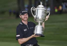 Jimmy Walker hoisted the Wanamaker Trophy in 2016. Who will be doing the honors this year.  (Photo courtesy of UPI.com).