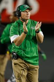 Marshall Coach Doc Holliday (above, photo, Zimbio) invade Raymond James Stadium to square off with Charlie Strong (Photo, FootballScoop) and his South Florida Bulls.
