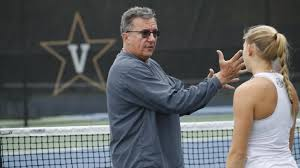 Coach Geoff McDonald and super charged up to watch his former player compete in the second round at the Aussie Open (Photo, Cracked Raquet).