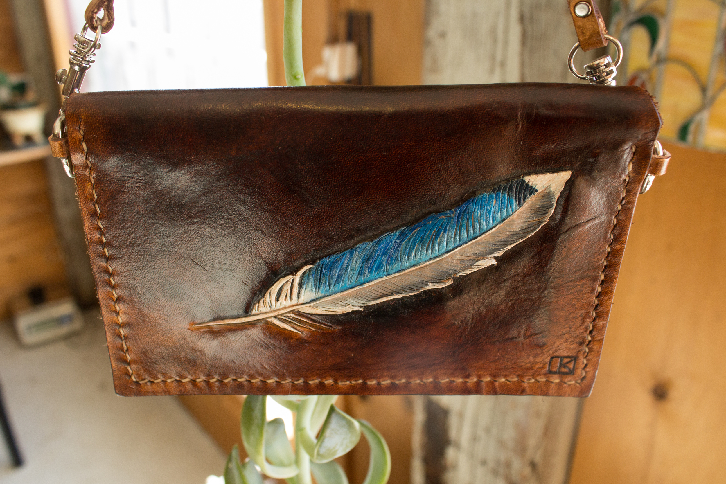 Blue bird feather handmade leather wristlet