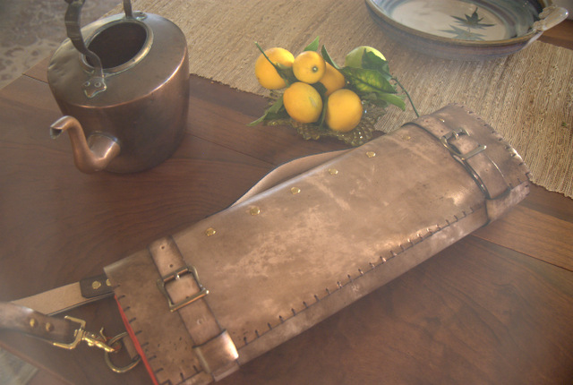 grey and red leather knife roll