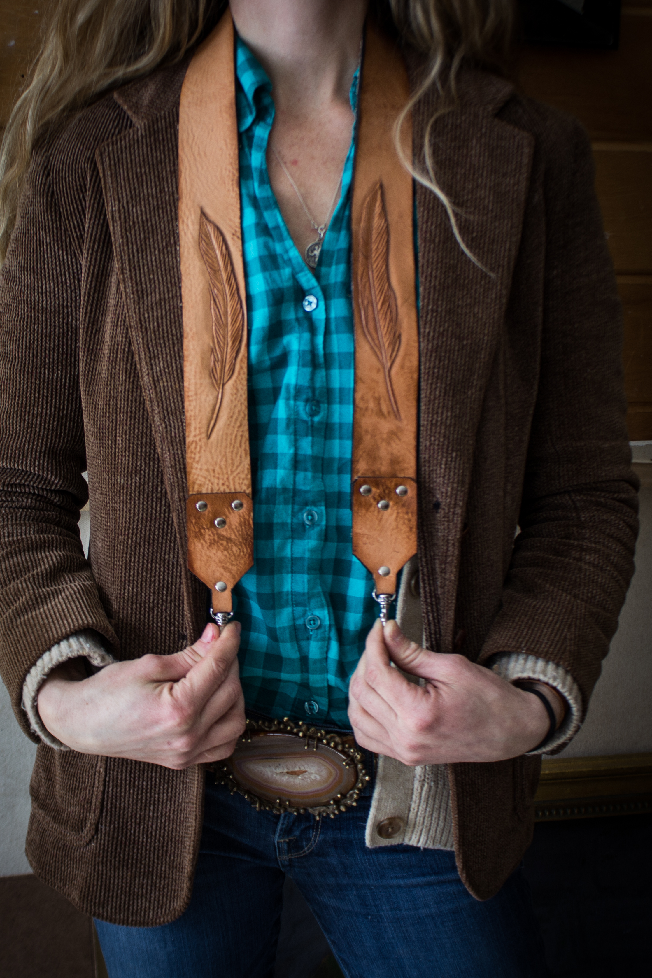 two feathers leather camera strap