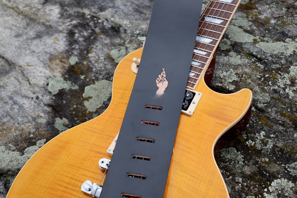 "The sign ""R"" guitar strap"