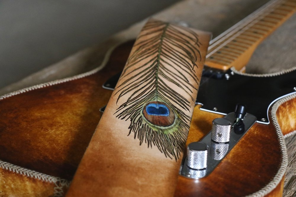 Peacock feather guitar strap