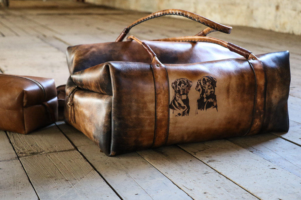 leather bag with black labs