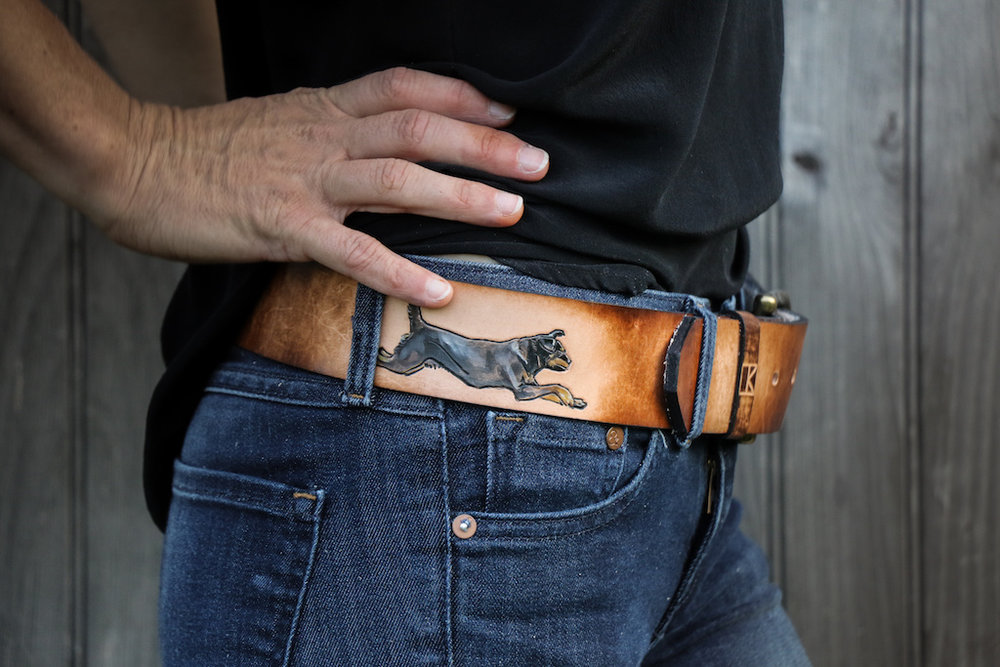 jumping dog leather belt by Linny Kenney
