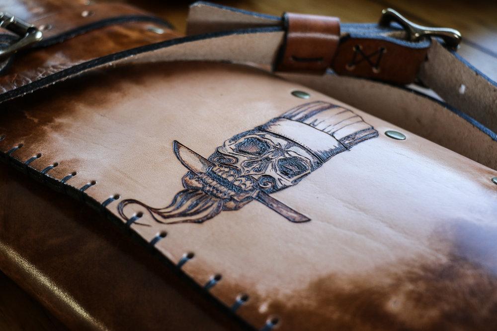 Bearded Skull Leather Knife Roll by Linny Kenney