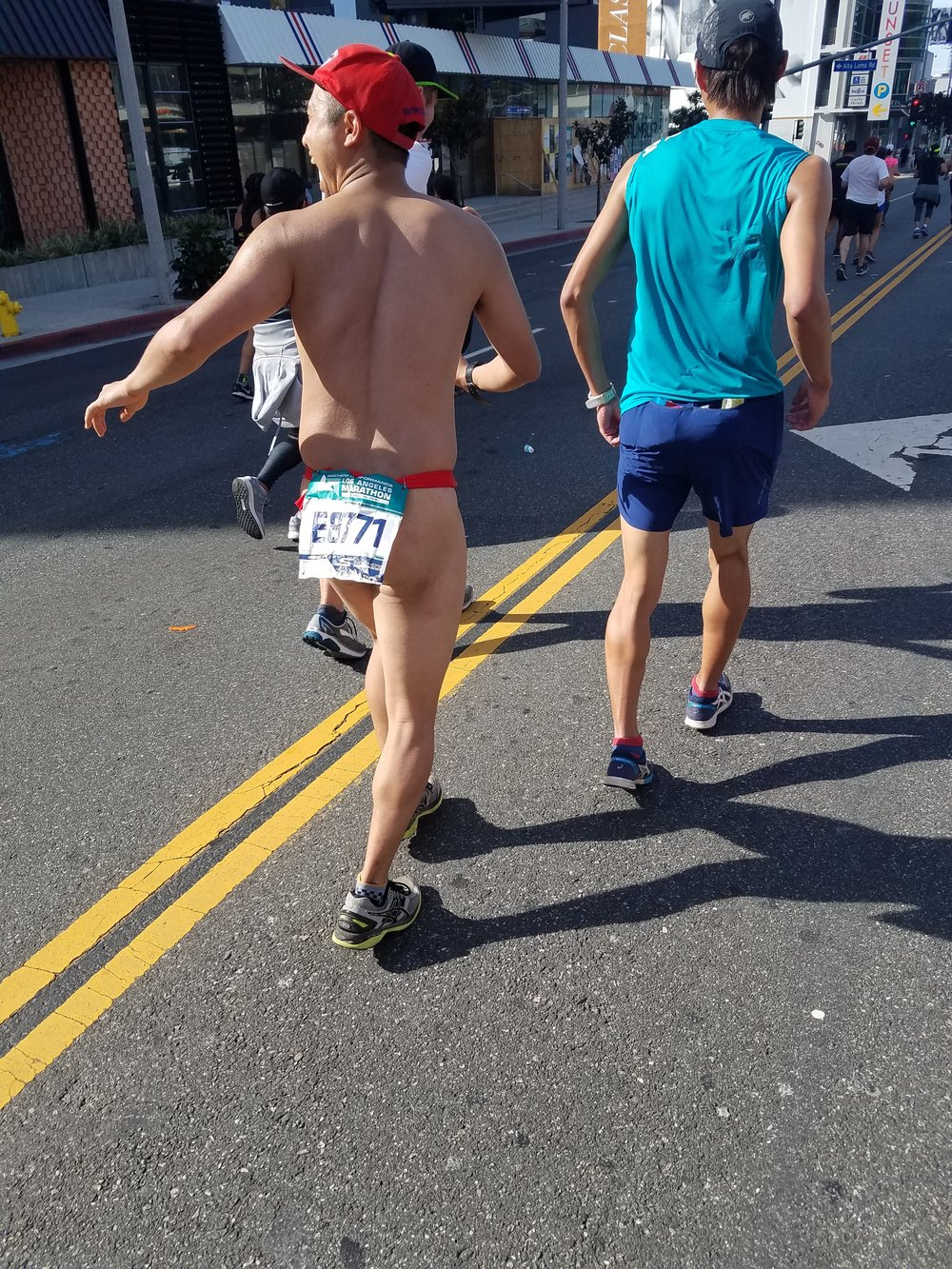 Mile 12: Sunset in West Hollywood. This guy. I told him how much I loved his confidence and how happy he made me. And he and his friend cheered. I ran near them for a few miles because watching people's reactions was absolutely life-giving. The thong man is officially a totem in my life.