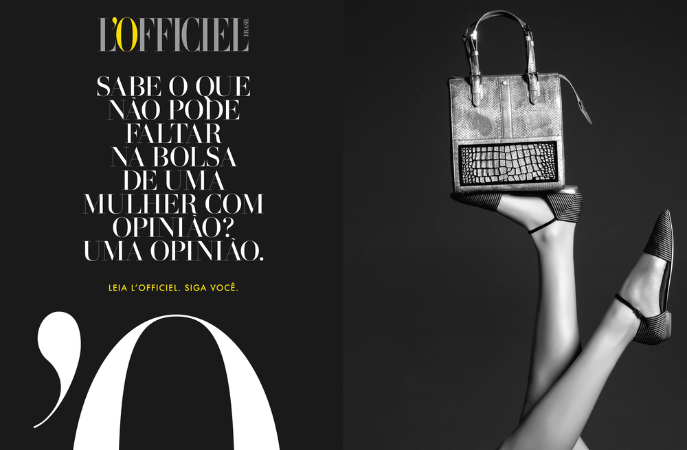 Translation note:  WHAT CAN'T BE ABSENT IN THE PURSE OF A WOMEN WITH AN OPINION? AN OPINION.   READ L'OFFICIEL. FOLLOW YOU.