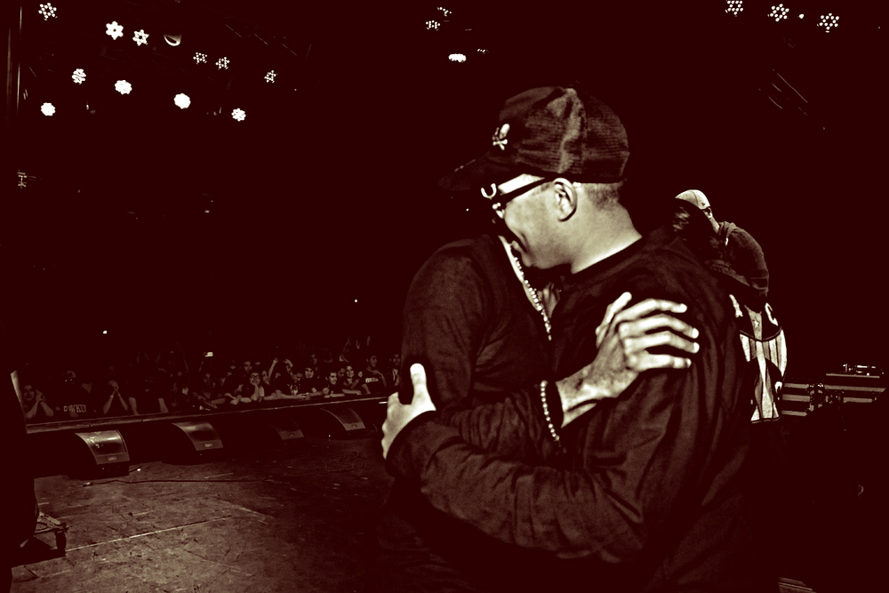 Jallal and Mos Def hugging.jpg
