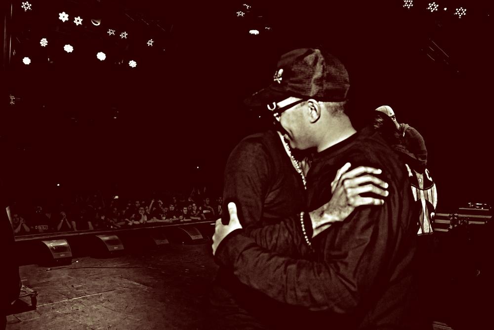 Jallal and Mos Def hugging.jpg