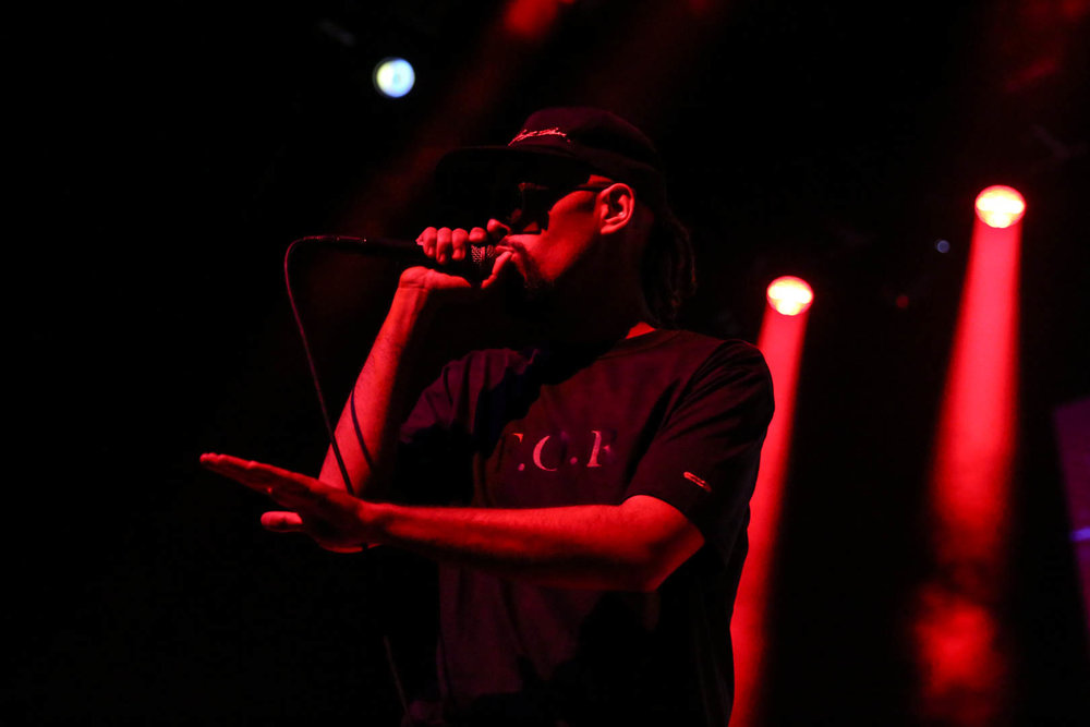 Jallal rapping in the red light.jpg