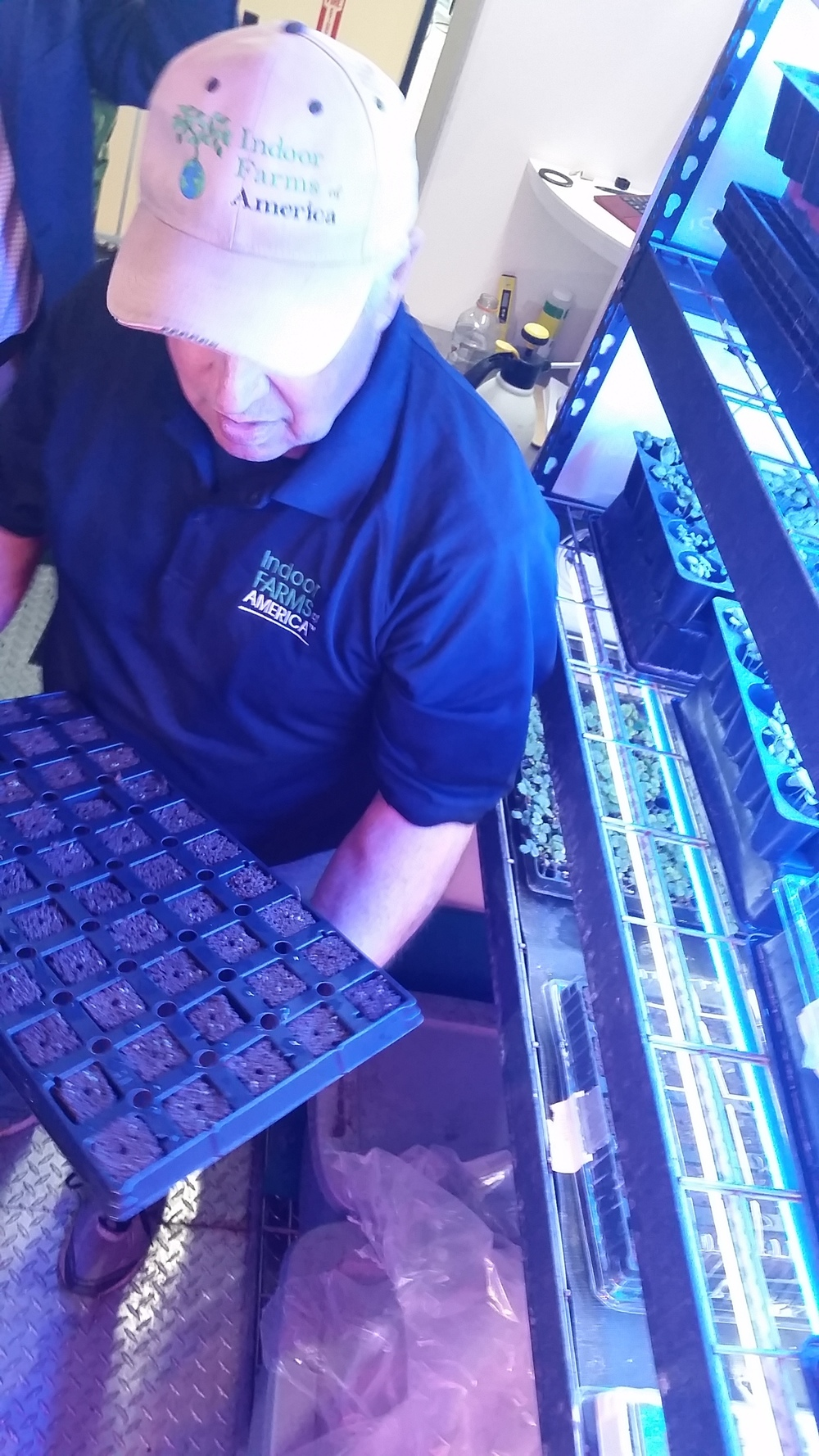 Ron Evans, Indoor Farms of America, holding a seedling tray
