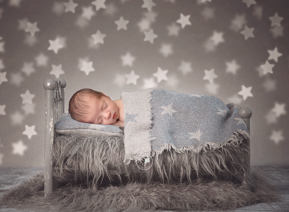 Boca-Raton-newborn-session-bed-stars.png