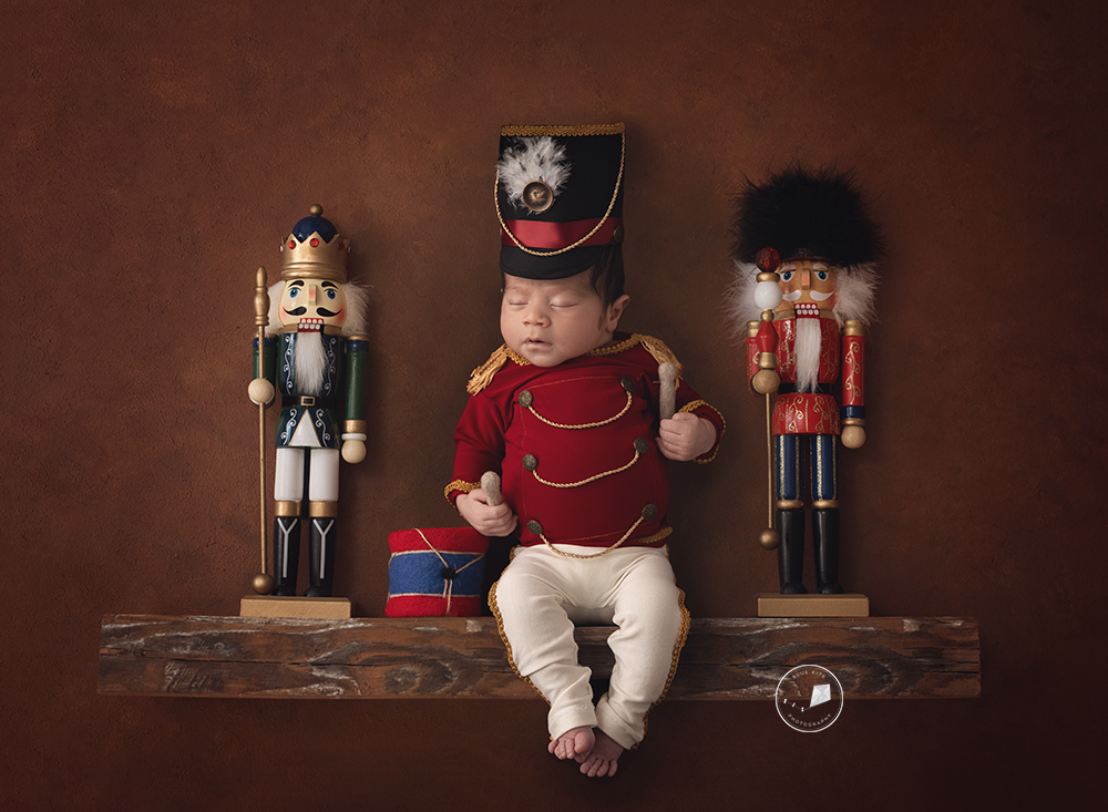 Boca-Raton-newborn-photographer-baby-on-shelf.png
