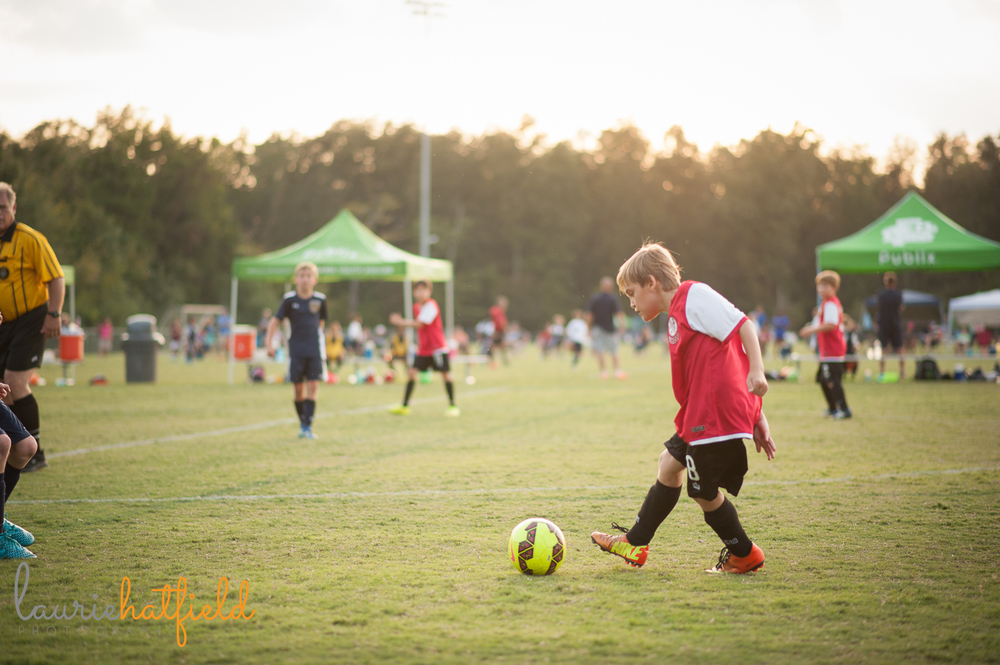 photo of boy playing soccer