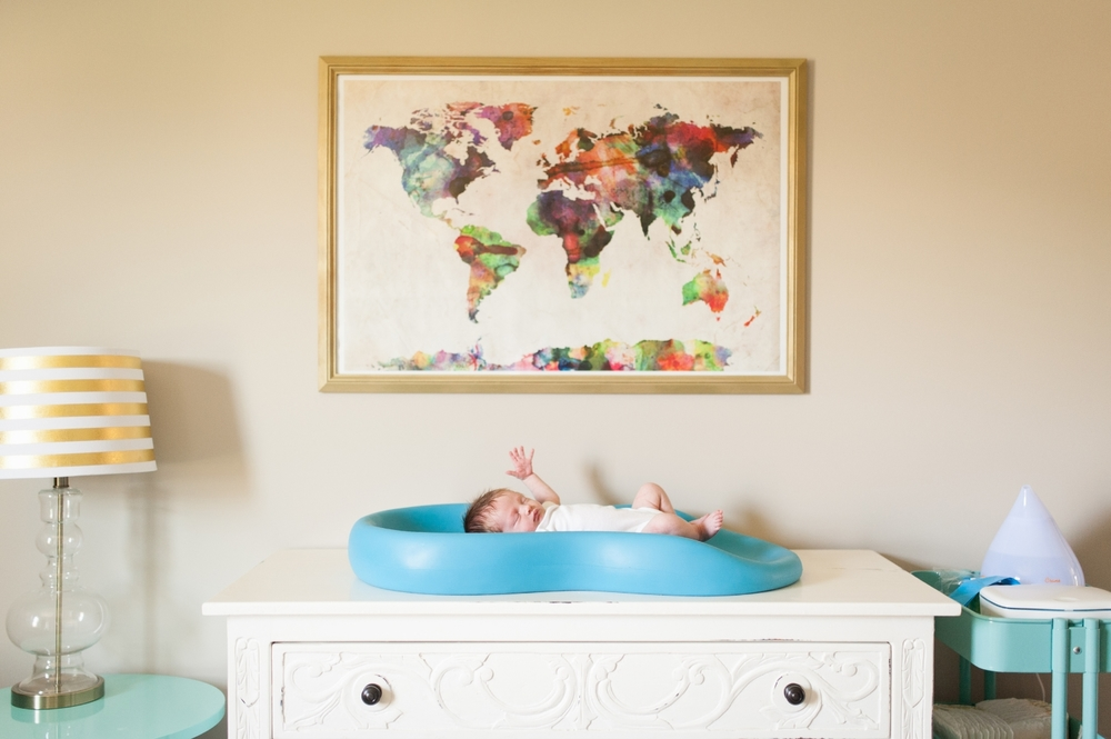 baby girl on changing table | Huntsville newborn photographer