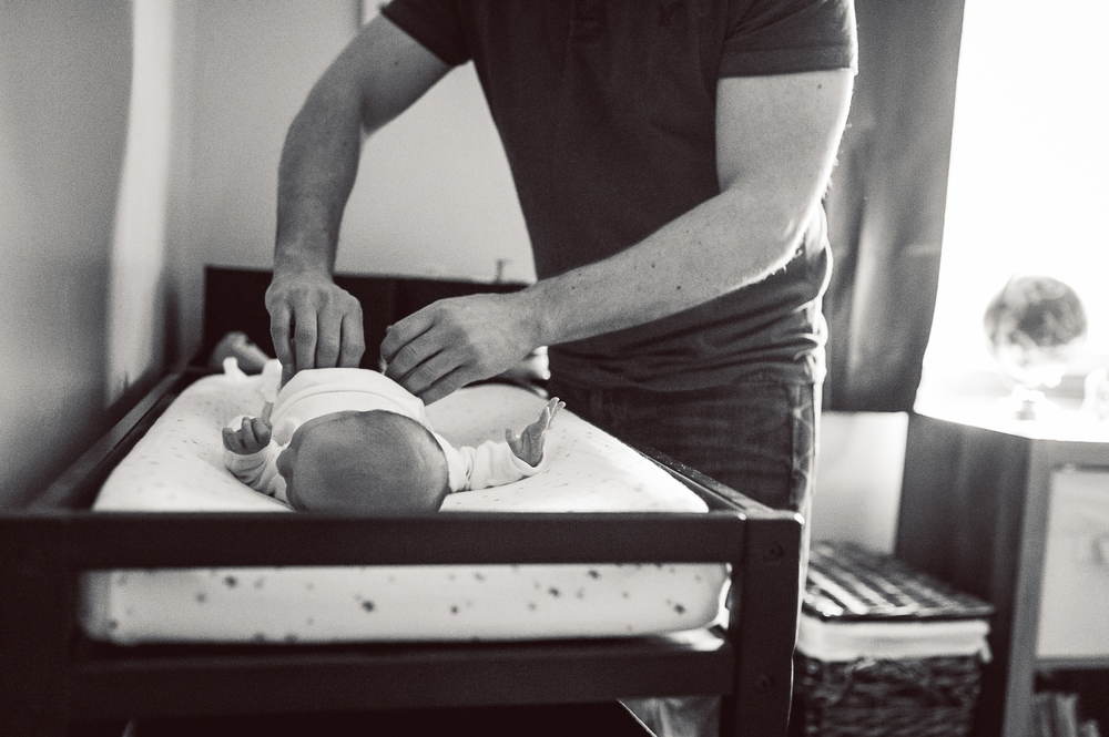 dad changing baby's diaper | Huntsville newborn photographer