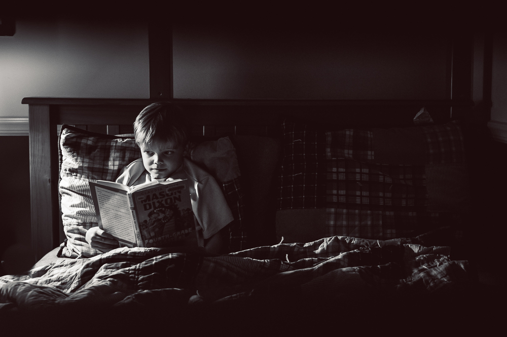 little boy reading in bed | Huntsville AL family photographer
