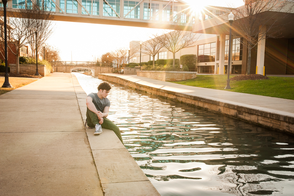 graduating guy sitting by water {huntsville senior portraits}