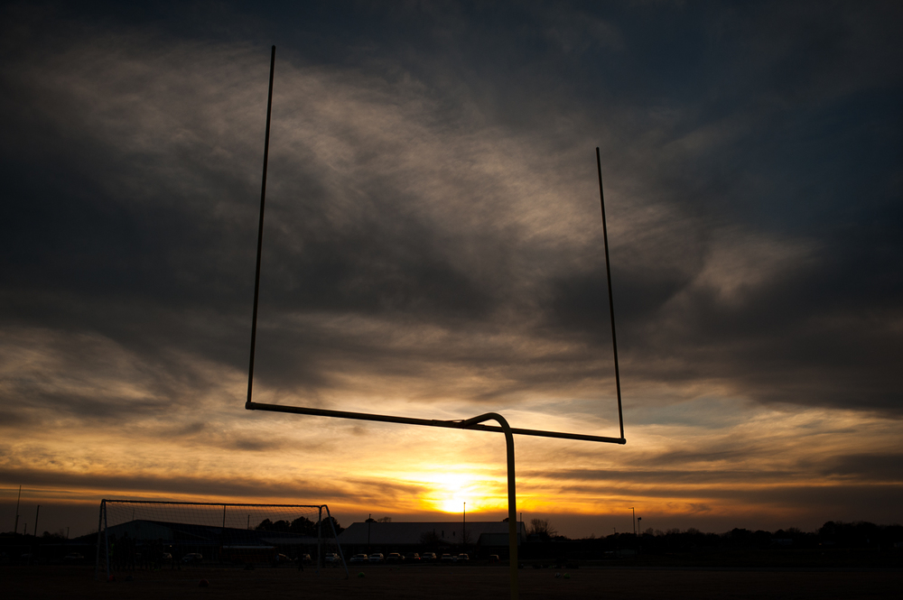 silhouette of football goalpost at sunset | huntsville family photographer